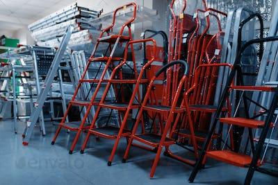 New aluminum stepladders in tool store, nobody