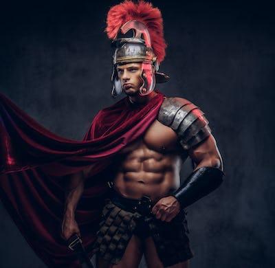 Portrait of a brutal Roman legionary in battle uniforms