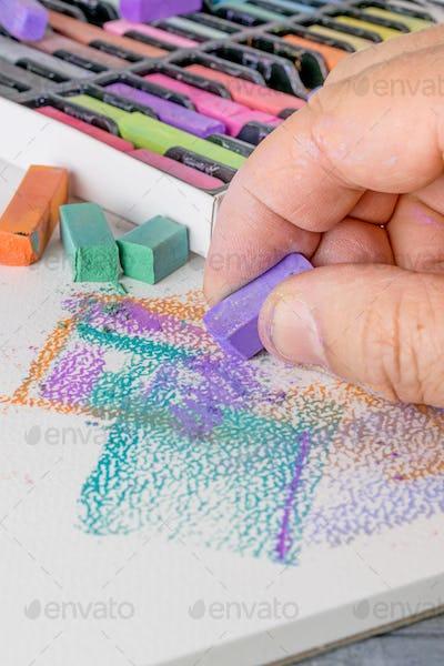 Artist using Soft Pastel Chalks
