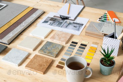 Marble tiles, wallpapers, color swatches, photos of home interior etc on desk