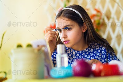 Pretty young girl following a makeup course online