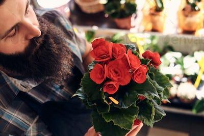 Professional male florist in flower shop