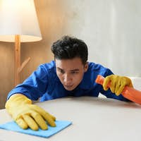 Man cleaning apartment