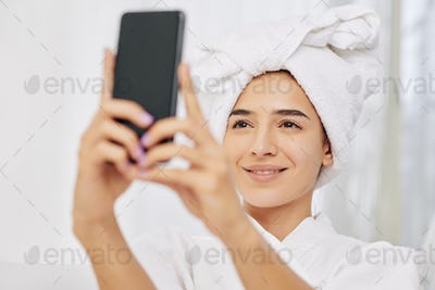 Woman photographing in bathrobe