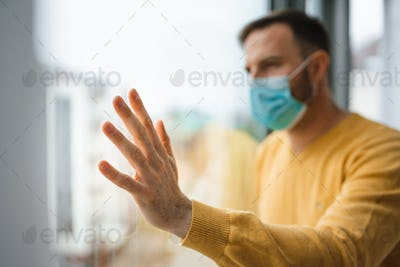 Man with mask to protect him from coronavirus. Quarantine, isolation, stay at home concept