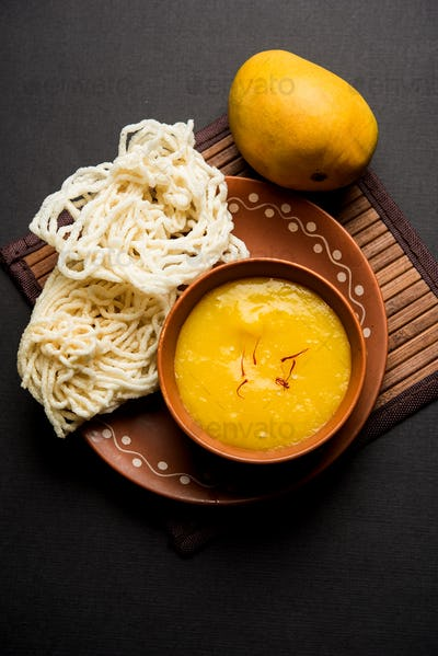 Indian food alphonso mango pulp with fried fritters