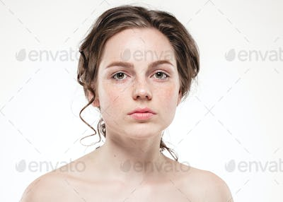 Beautiful face woman freckles and curly fly hair