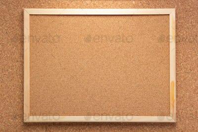 cork board in wooden frame as background