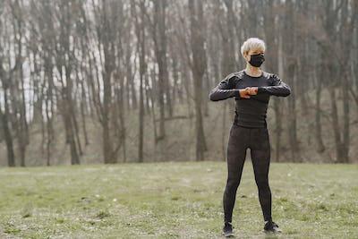 Masked woman training during coronavirus
