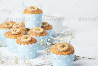 Banana muffin in blue cake cases paper, side view, close up, copy space. Morning breakfast