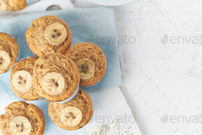 Banana muffin, top view, close up, copy space. Morning breakfast on blue napkin