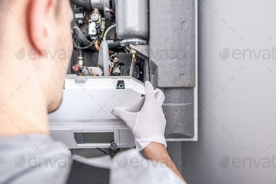 Contractor Repairing Central Heating Furnace System.