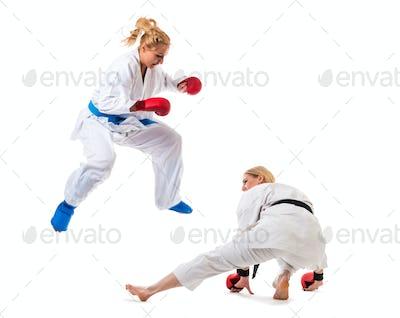 Cute blonde girls training karate on white