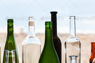 various empty bottles and view of city park