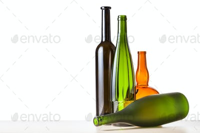 empty bottles on board with cutout background