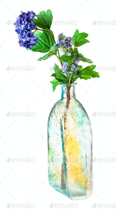 artificial flowers in hand painted flask isolated