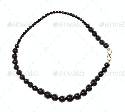 necklace from polised jet stone isolated