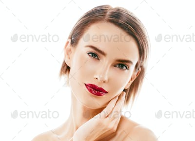 Young beautiful woman with red lips. Healthy perfect beauty skin and natural makeup.