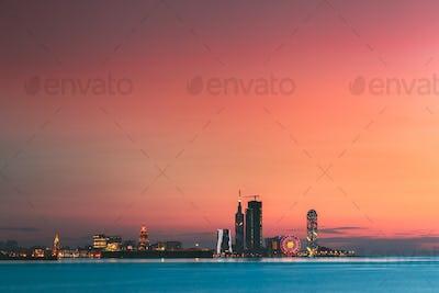 Batumi, Adjara, Georgia. Sunset Or Sunrise. Bright Evening Sky In Yellow, Orange And Blue Colors