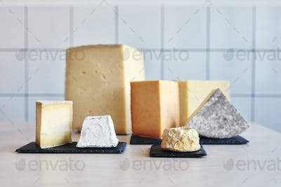 Still life of a range of cheeses on table top