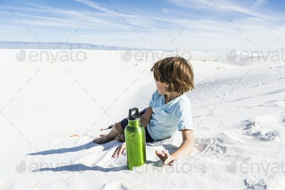 6 year old boy with green water bottle, White Sands Nat'l Monument