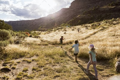 children hiking at sunset,Pilar, NM.