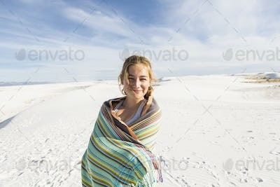 A teenage girl in the open landscape of White Sands Nat'l Monument, NM