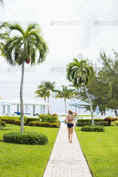 rear view of 13 year old girl walking to pool