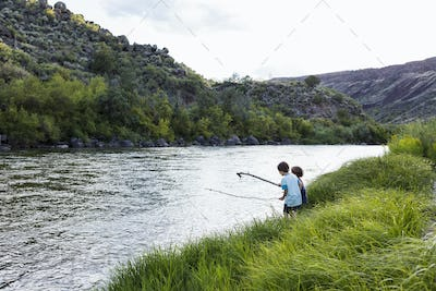 2 boys playing at the edge of the Rio Grande River, Pilar, NM.