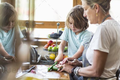 mother and her 5 year old son in the kitchen