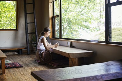 Japanese woman sitting at a table in a Japanese restaurant.