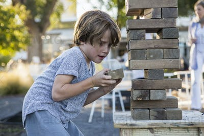 6 year old boy playing with giant jigsaw puzzle