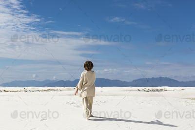 6 year old boy walking in sand dnes.