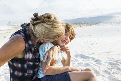 mother and her 6 year old son embracing, White Sands Nat'l Monument, NM