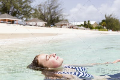 13 year old girl floating in the ocean