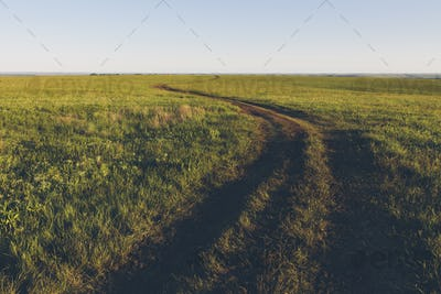 View across the wide open space of the Tallgrass Prairie Preserve in spring, with lush grass and a