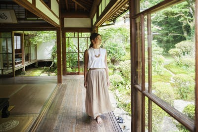 Japanese woman standing in Buddhist temple.