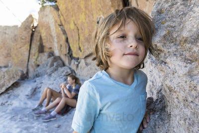 Family visiting the Tsankawi Ruins, a young boy exploring.