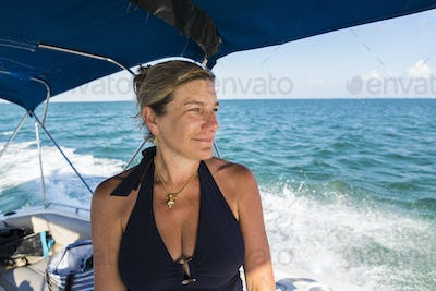 smiling adult woman on boat