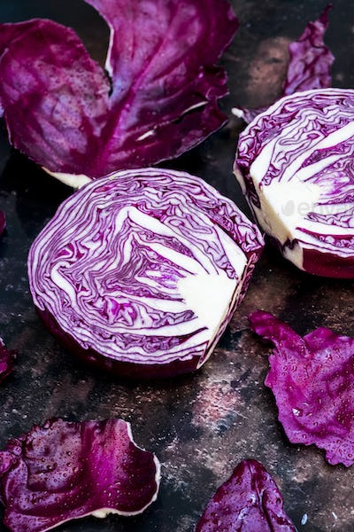 A raw round red cabbage, cut across the middle.