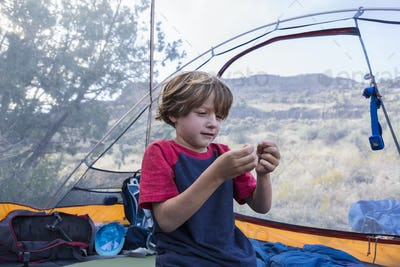 6 year old boy playing in tent