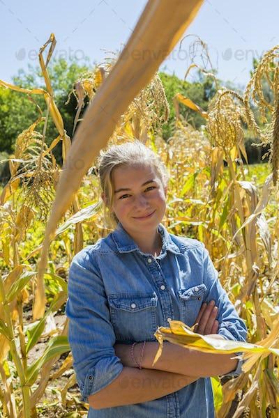 portrait of 13 year old girl in corn field
