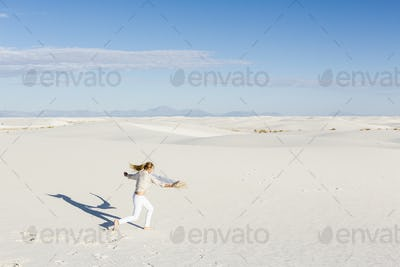13 year old girl dancing in the dunes, White Sands Nat'l Monument, NM