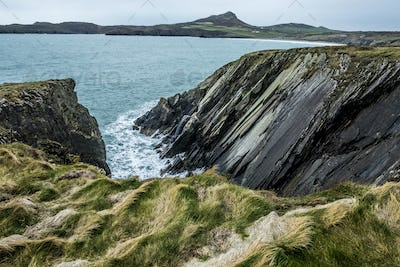 View along the coastline with rocky cliffs, Pembrokeshire National Park, Wales, UK.