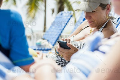 woman texting on smart phone while on vacation