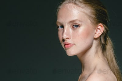 Beautiful Blonde Woman Beauty Model Girl with perfect makeup over black background.
