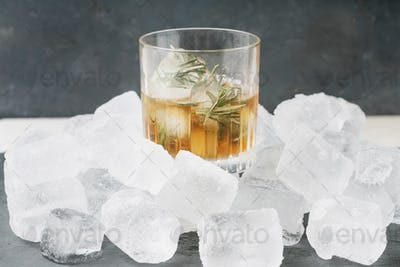 Misted glass of whiskey on the rocks