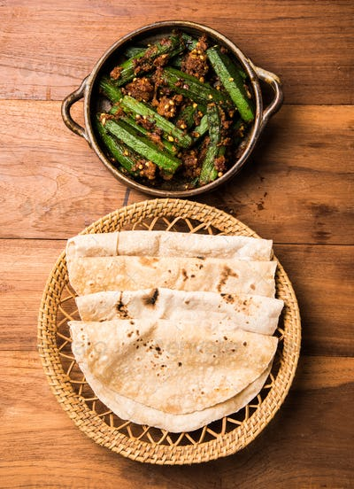 Indian masala fried Okra / bhindi or ladyfinger curry served with chapati