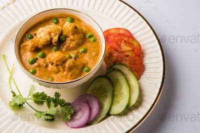 Indian spicy food Gobi Masala or cauliflower curry with green peas
