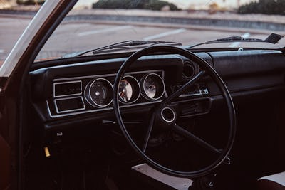 Steering wheel and dashboard. Interior of a restored retro car.